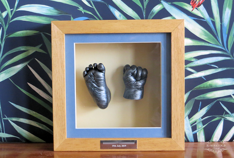 silver baby casts in solid wood frame with blue mount